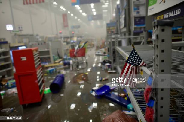 An American flag drapes across looted shelves in a hardware store during widespread unrest following the death of George Floyd on May 31 2020 in...