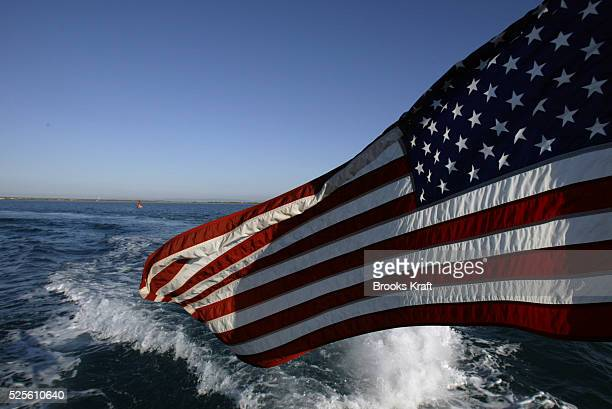 An American flag flies above a US Naval vessel crossing Guantanamo Bay near the Guantanamo Bay Naval Base in Cuba