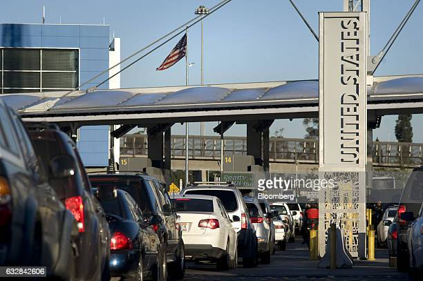 An American flag flies above early morning traffic at the San Ysidro Port of Entry for the US and border crossing in Tijuana Mexico on Thursday Jan...