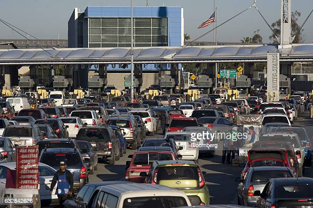 An American flag flies above early morning traffic at the San Ysidro Port of Entry for the US and Mexico border crossing in Tijuana Mexico on...