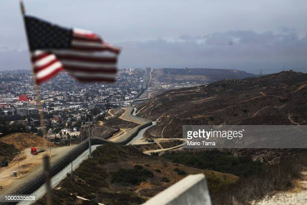 An American flag flies along a section of the USMexico border fence on July 16 2018 in San Diego California The entire Southwest border saw 34114 US...