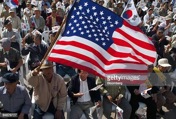 An American flag flies alongside South Korean flags at a rally against North Korea in Seoul South Korea on Friday October 13 2006 South Korean...