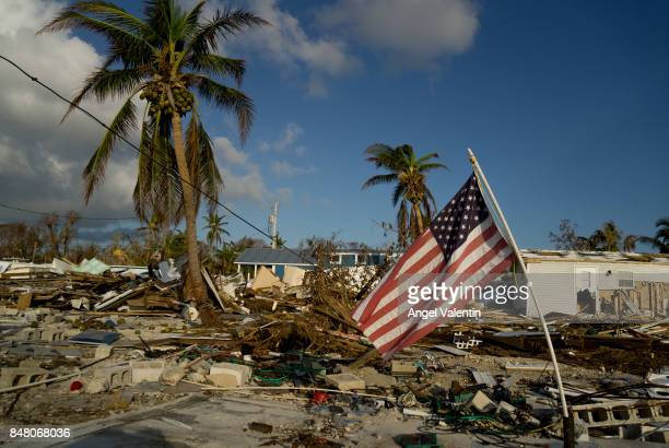 An American flag flies amid the destruction in the Sea Breeze trailer park in Plantation Key on September 16 2017 in Marathon Florida Many places in...