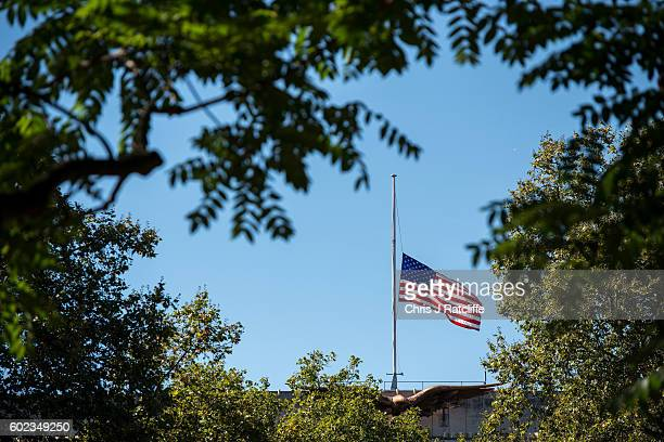 An American flag flies at half mast over the American Embassy in tribute to victims of the 9/11 terroism attacks at on September 11 2016 in London...