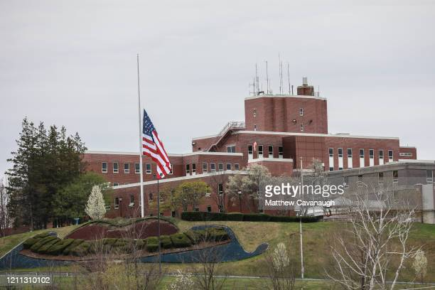 An American flag flies at half-mast outside the Holyoke Soldiers' Home on April 29, 2020 in Holyoke, Massachusetts. In one of the deadliest known...