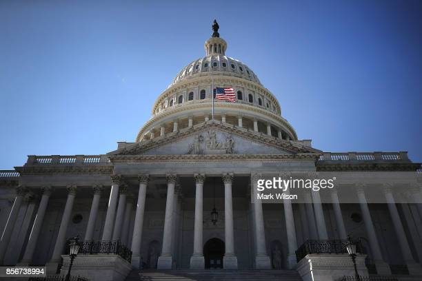 An American flag flies at halfstaff at the US Capitol on October 2 2017 in Washington DC President Donald Trump ordered the flags on all federal...