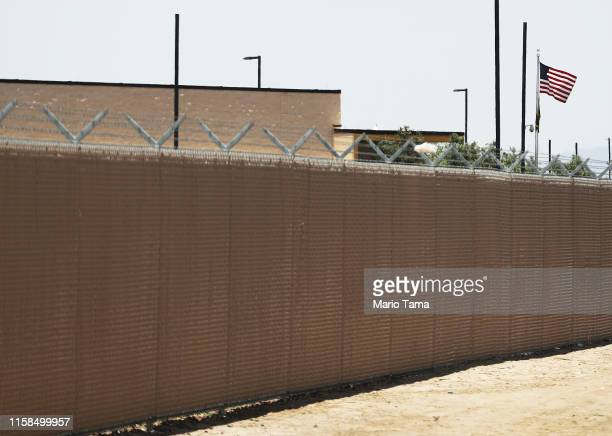 An American flag flies at the U.S. Border Patrol station where lawyers reported that detained migrant children had been held unbathed and hungry on...
