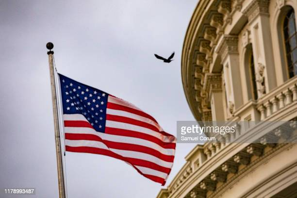 An American flag flies at the US Capitol on October 30 2019 in Washington DC State Department special adviser for Ukraine Catherine Croft and State...