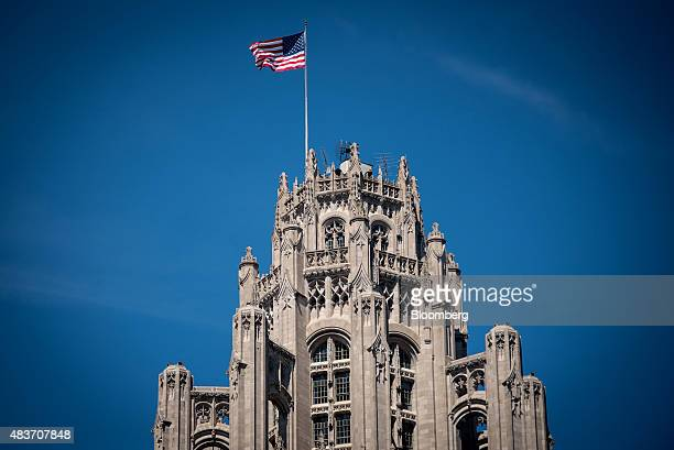 An American flag flies atop the Tribune Tower in Chicago Illinois US on Friday Aug 7 2015 Tribune Media Co is scheduled to report secondquarter...