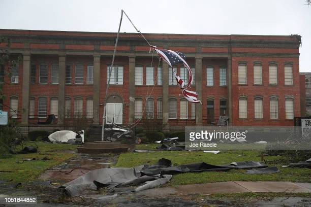 An American flag flies from a broken flag pole after hurricane Michael passed through the downtown area on October 10 2018 in Panama City Florida The...