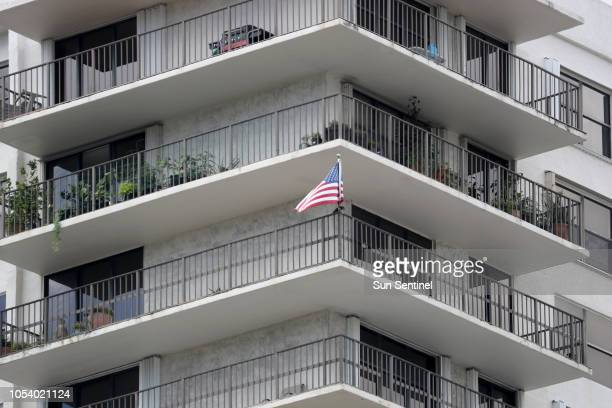 An American flag flies from the balcony of an apartment in the building in Aventura Calif Friday Oct 26 where the bombing suspect Cesar Sayoc's...