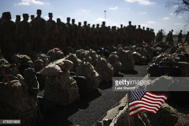 An American flag flies from the rucksack of soldier with the US Army's 3rd Brigade Combat Team 1st Infantry Division outside a homecoming ceremony in...