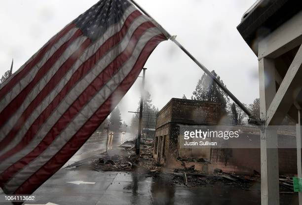 An American flag flies in front of a business that was destroyed by the Camp Fire on November 21 2018 in Paradise California Fueled by high winds and...