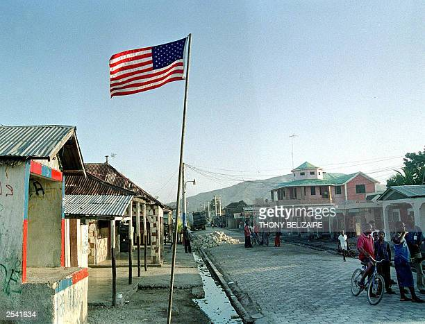An American flag flies in Rabeauto a slum in Gonaives Haiti 171 km from PortauPrince 27 September 2003 after protesters erected it calling for US...