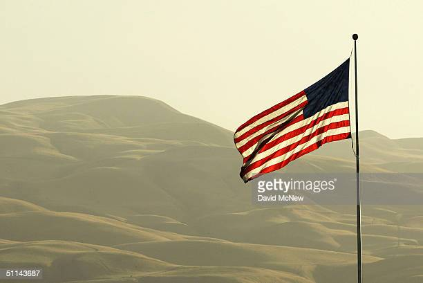 An American flag flies near the hills of the Wind Wolves Preserve on August 3 2004 north of the Los Padres National Forest California The Bush...