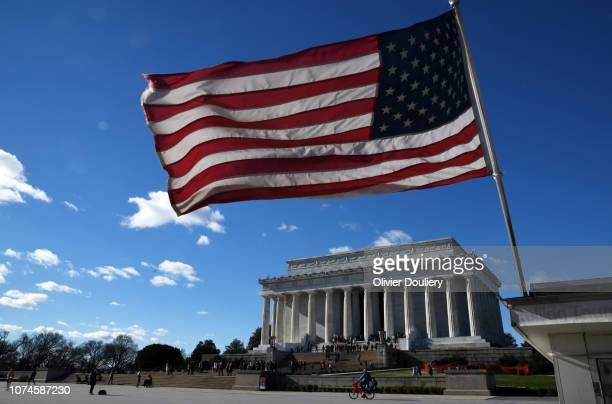 An American flag flies near the Lincoln Memorial on December 22, 2018 in Washington, DC. The government partially shutdown at midnight after congress...