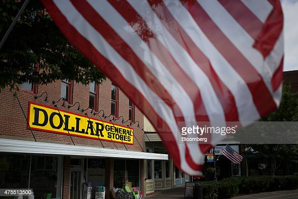 An American flag flies outside a Dollar General Corp store in Scottsville Kentucky US on Tuesday May 26 2015 Dollar General Corp is expected to...