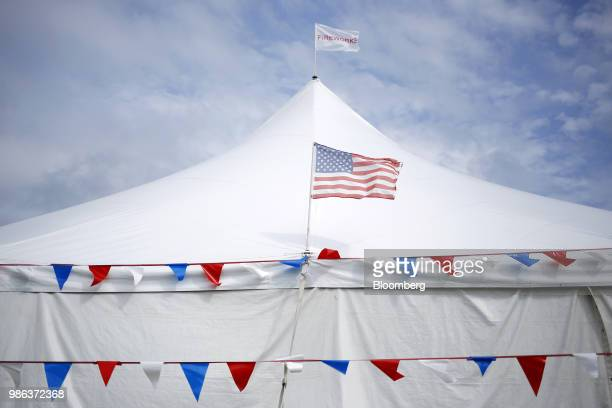 An American flag flies outside a roadside fireworks tent in Radcliff Kentucky US on Wednesday June 27 2018 Acording to the American Pyrotechnics...