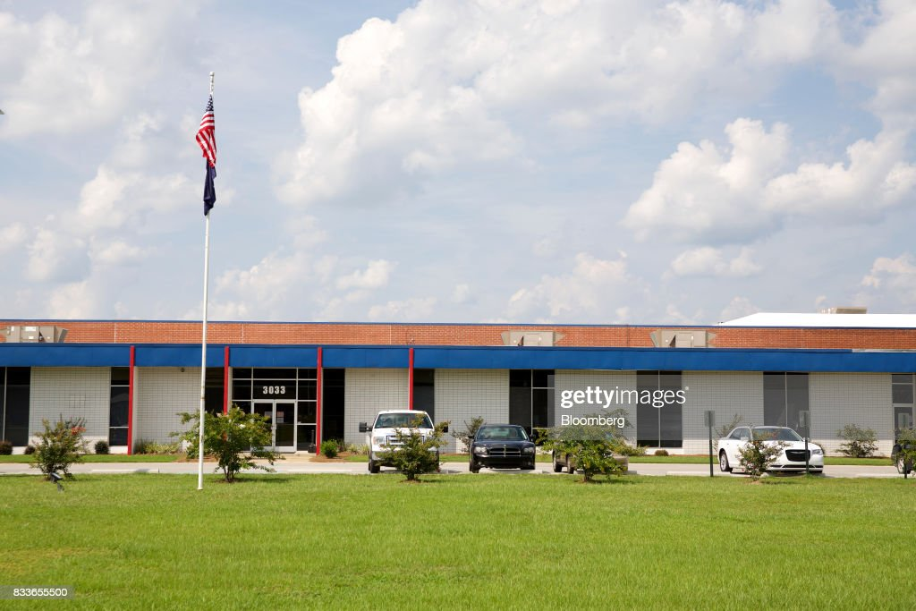 An American flag flies outside The Kent International Inc. Bicycle Corporation of America brand Assembly facility in Manning, South Carolina, U.S., on Sunday, June 25, 2017. Almost all of the roughly 18 million bicycles sold each year in the U.S. come from China and Taiwan. This year, about 130 workers at the Bicycle Corporation of America's new factory will assemble 350,000 bikes in the U.S. Photographer: Travis Dove/Bloomberg via Getty Images
