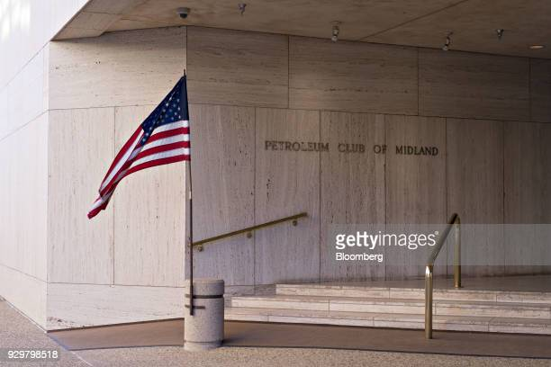 An American flag flies outside the Petroleum Club of Midland in Midland Texas US on Thursday March 1 2018 Chevron the world's thirdlargest publicly...