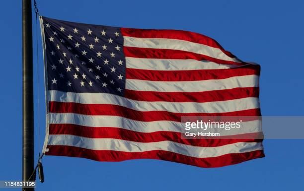An American flag flies over a monument marking the location of the Alexander Hamilton Aaron Burr Dueling Ground at sunset on June 3 2019 in Weehawken...
