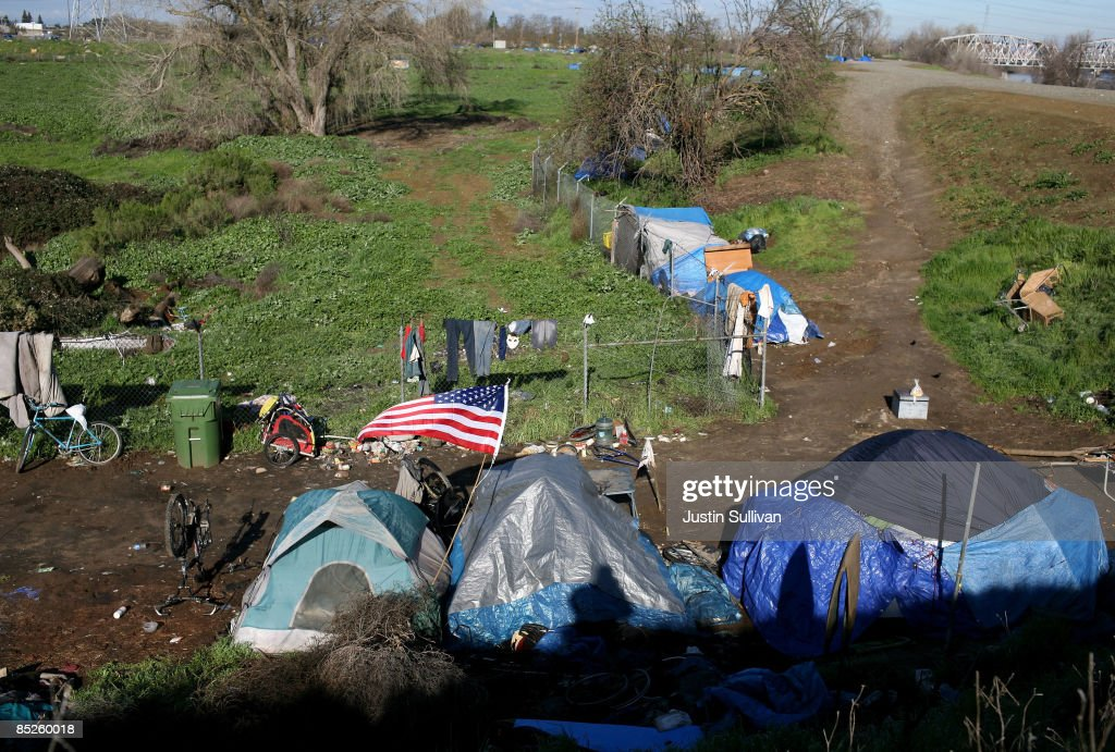 An American flag flies over a tent at a homeless tent city on March 5 & Sacramento Tent City Fills Up Jobless And Homeless Photos and ...