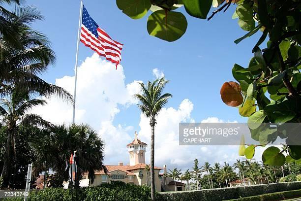 An American flag flies over Donald Trump's MarALago club November 1 2006 in Palm Beach Florida The town of Palm Beach has cited Donald Trump because...