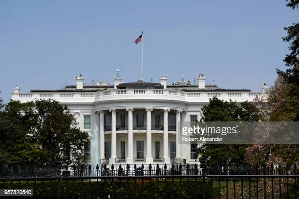 An American flag flies over the south facade of the White House in Washington DC Additional security fences and barriers were added along the south...