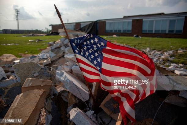 An American flag flys in front of a damaged school area in Dayton Ohio on May 28 after powerful tornadoes ripped through the US state overnight...