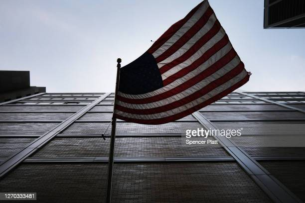 An American Flag hangs from a building in the Financial District on September 02, 2020 in New York City. The Dow gained 454.84 points, or 1.59...