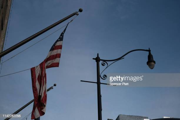 An American flag hangs from a building on April 11, 2019 in Binghamton, New York. Due to an aging population, falling birthrates and slowing...