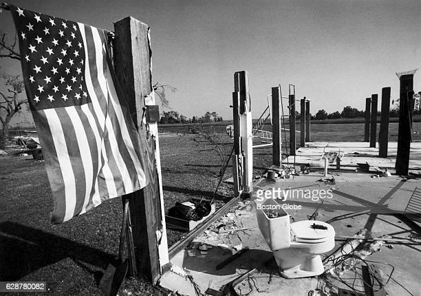 An American flag hangs from the ruins of a home in the Shellmore section of McClellanville SC on Oct 4 1989 All 14 homes in Shellmore were leveled...