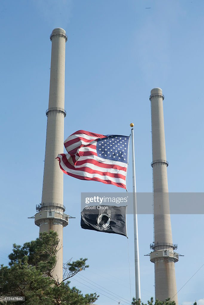 An American flag hangs in front of NRG Energy's Joliet Station power plant on May 7, 2015 in Joliet, Illinois. According to scientists, global carbon dioxide (CO2) concentrations have reached a new monthly record of 400 parts per million, levels that haven't been seen for about two million years. The Environmental Protection Agency (EPA) reports the combustion of fossil fuels to generate electricity is the largest single source of CO2 emissions in the United States, followed by the burning of fossil fuels for transportation.