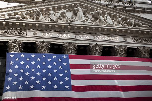 An American flag hangs off the front of the New York Stock Exchange building in the Wall Street financial district June 5 2012 in New York City