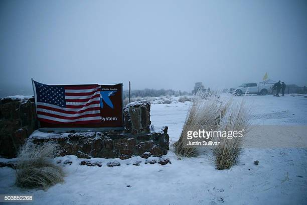 An American flag hangs on a sign at the entrance to the Malheur National Wildlife Refuge on January 7 2016 near Burns Oregon An armed antigovernment...