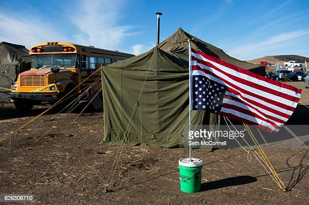 An American Flag hangs upside down outside of the veterans bunk house at Oceti Sakowin Camp on the Standing Rock Sioux Reservation in Canon Ball...