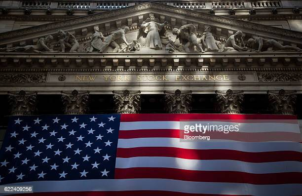 An American flag is displayed at the New York Stock Exchange in New York US on Friday Nov 11 2016 US stocks fluctuated in whipsaw trading with the...