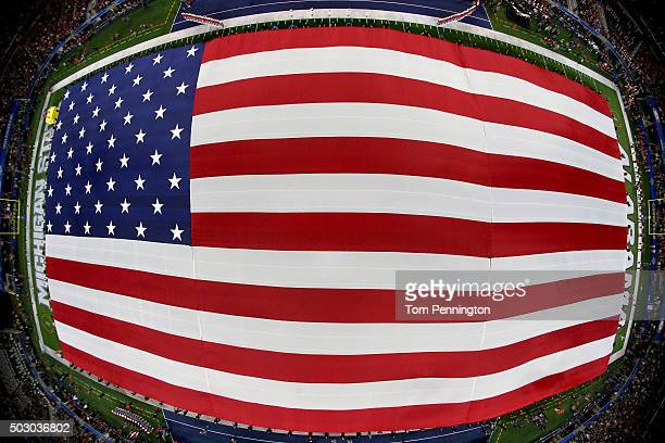 An American flag is displayed during pregame ceremonies for the Goodyear Cotton Bowl between the Alabama Crimson Tide and the Michigan State Spartans...