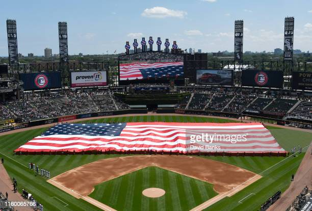 An American flag is displayed during the national anthem before the game between the Chicago White Sox and the Detroit Tigers at Guaranteed Rate...