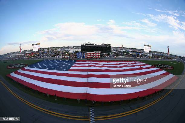 An American flag is displayed in the infield prior to the Monster Energy NASCAR Cup Series 59th Annual Coke Zero 400 Powered By CocaCola at Daytona...