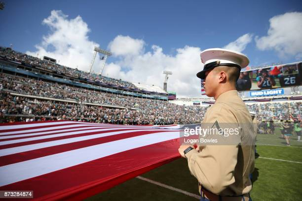 An American flag is displayed on the field prior to the start of the game between the Los Angeles Chargers and the Jacksonville Jaguars at EverBank...