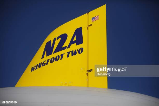 An American flag is displayed on the wing of the Goodyear Tire Rubber Co Wingfoot Two blimp at the company's airship base in Carson California US on...