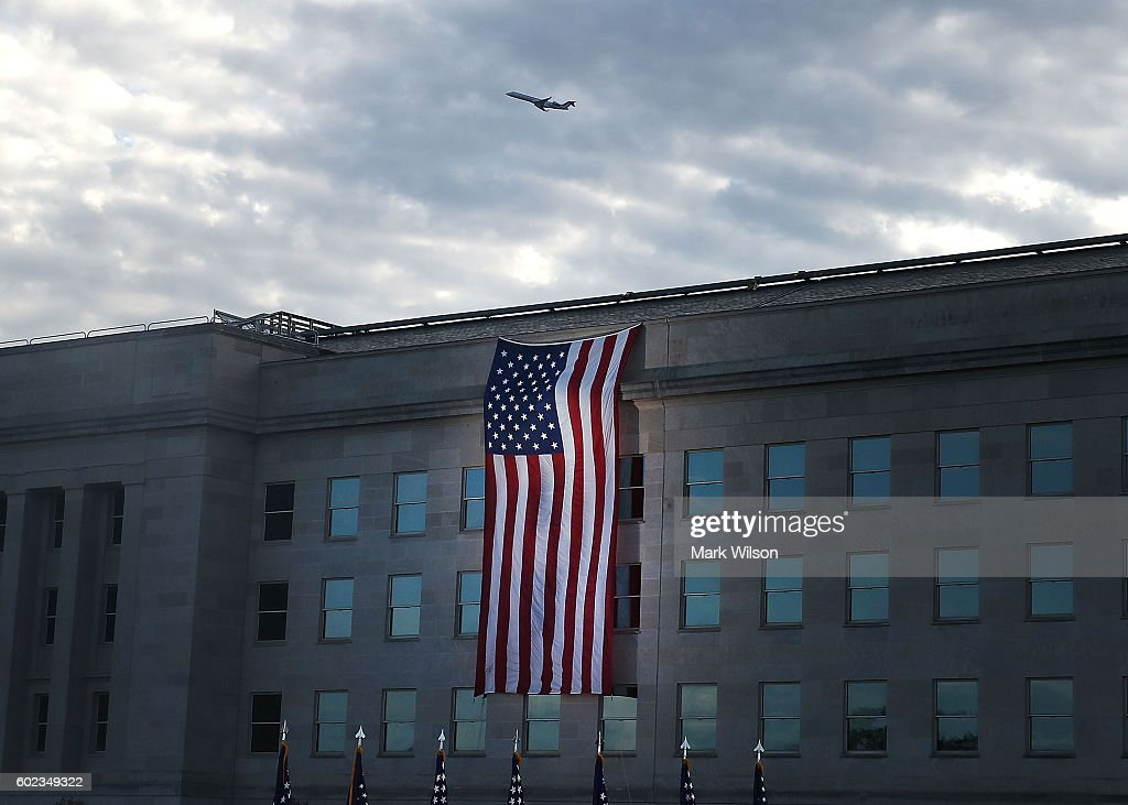 An American flag is draped over the Pentagon where it was hit by an airliner 15 years ago, September 11, 2016 in Arlington, Virginia. Later in the day President Obama will visit the Pentagon and speak on 15th anniversary of the September 11th terrorist attacks that killed nearly 3,000 people at the World Trade Center, Pentagon and on Flight 93.