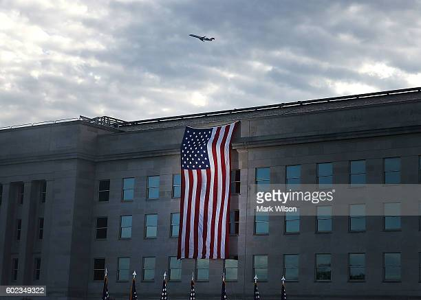 An American flag is draped over the Pentagon where it was hit by an airliner 15 years ago September 11 2016 in Arlington Virginia Later in the day...