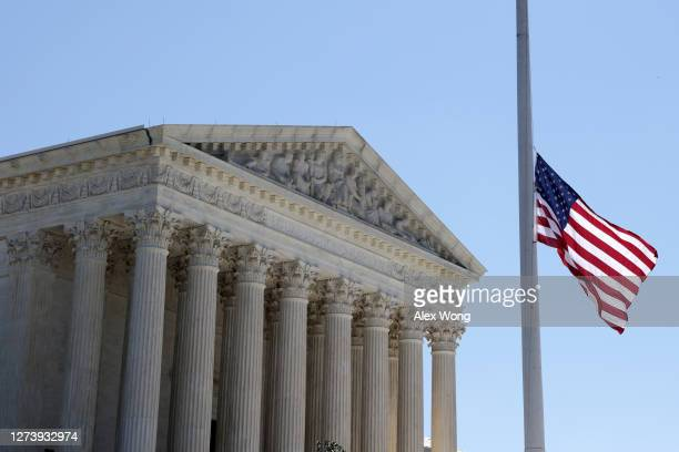 An American flag is flown at half staff in front of the U.S. Supreme Court for the late Justice Ruth Bader Ginsburg September 21, 2020 in Washington,...