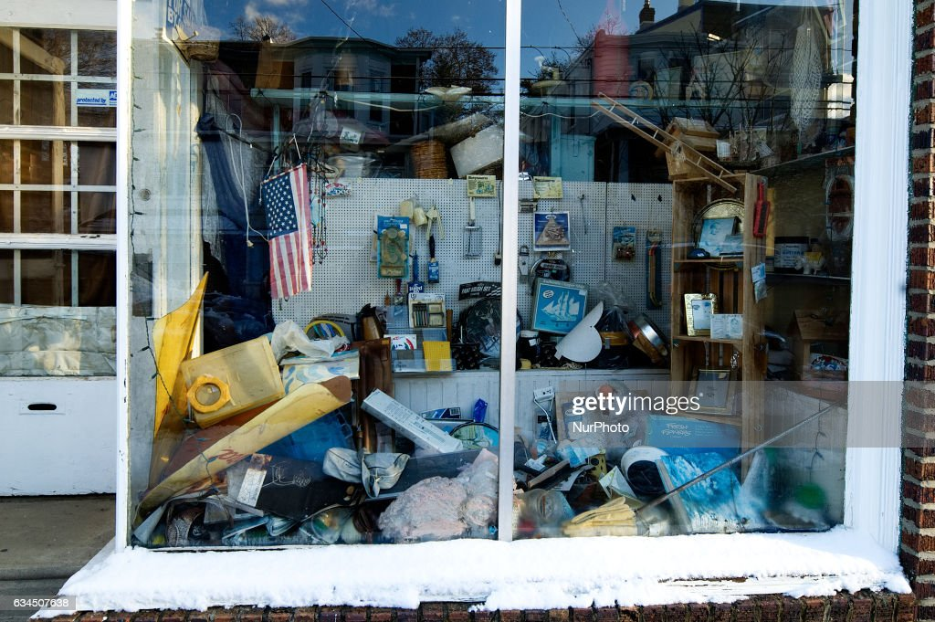 An American flag is found with an random assortment of other items in a window display in Philadelphia, PA, on February 9th, 2017. The store in the liberal and diverse Northwest Philadelphia neighborhood of West Mount Airy seems to be out of business.