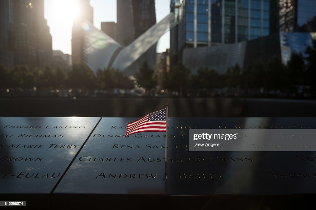 An American flag is left at the North pool memorial site before a commemoration ceremony for the victims of the September 11 terrorist attacks at the National September 11 Memorial, September 11, 2017 in New York City. In New York City and throughout the United States, the country is marking the 16th anniversary of the September 11 terrorist attacks.