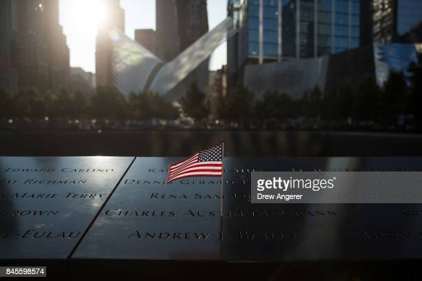 An American flag is left at the North pool memorial site before a commemoration ceremony for the victims of the September 11 terrorist attacks at the...