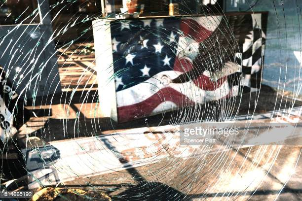 An American Flag is painted inside of closed business in the struggling city of Warren on July 14, 2017 in Warren, Ohio. Warren, a city that was once...