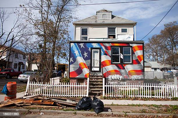 An American flag is painted on a house damaged during Hurricane Sandy on October 27, 2013 in Staten Island borough of New York City. Hurricane Sandy...